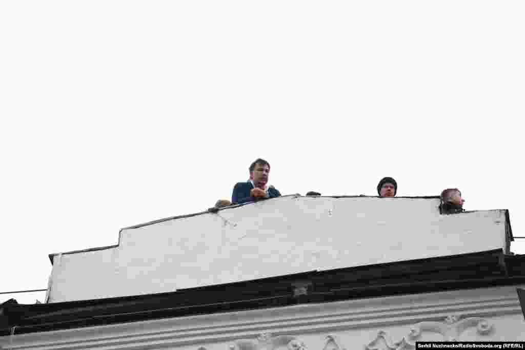 Mikheil Saakashvili, the former president of Georgia, ex-governor of Ukraine's Odesa region, and opponent of Ukraine's President Petro Poroshenko, shouts to supporters from the roof of the apartment building where he had been staying.