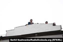 Saakashvili speaks from the roof of his apartment building before being detained.