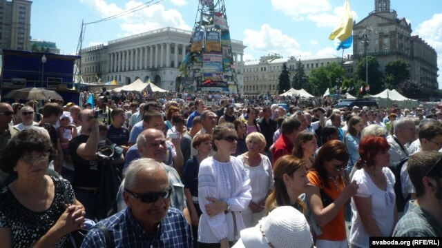 "Demonstrators in Kyiv on June 29 demanded the government continue its ""antiterrorist"" operation in eastern Ukraine against pro-Russian separatists."