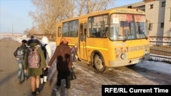 Children board a school bus in the Kurgan region.