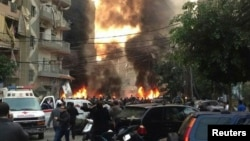 Fire and smoke billows from the site of an explosion in Beirut's southern suburbs on January 2.