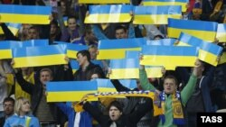 Ukrainian soccer fans cheer during the 2014 World Cup qualifying soccer match between Ukraine and England in Kyiv on September 10.