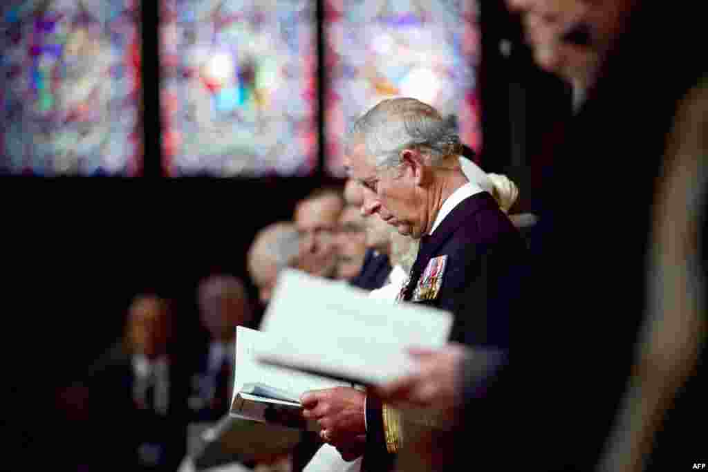 Britain's Prince Charles listens to the service during a British D-Day commemoration ceremony at Bayeux Cathedral.