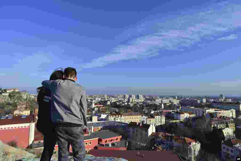 A couple takes in a view of Plovdiv, the first Bulgarian city to become a European Capital of Culture. The EU initiative is intended to celebrate the diversity of cultures in Europe, boost tourism, and support the cultural life of the selected cities.