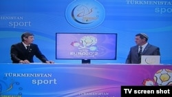 Commentators from Turkmenistan Sport discuss the Euro 2012 football championship live during a broadcast on June 11.