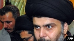 Shi'ite cleric Muqtada al-Sadr, surrounded by bodyguards, arrives in his stronghold of Najaf on January 5.