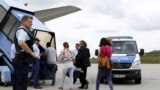 Germany -- Albanian and Kosovo refugees board an airplane to Tirana and Prishtina, at Munich airport, July 14, 2015