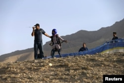 Afghan paraglider Zakia Mohammadi prepares to take flight in Kabul.