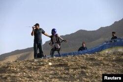 Afghan paraglider Zakia Mohammadi prepares to take flight in Kabul.