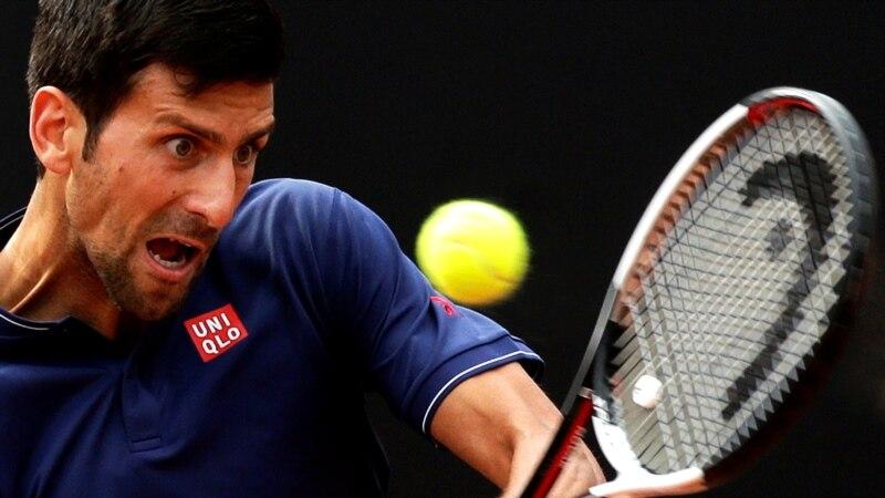 Serbia's Djokovic Defeats Rival Federer; Romania's Halep Loses