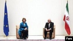 Координатор зовнішньої політики ЄС Катрін Аштон та міністр закордонних справ Ірану Могаммад Джавад Заріф, Женева, 15 жовтня 2013 року