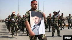 Iraq--Thousands of heavily-armed Shiite militiamen paraded through several Iraqi cities Saturday