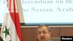 Міністр внутрішніх справ Сирії Мохаммад аш-Шаар оприлюдює 27 лютого 2012 року результати недільного референдуму