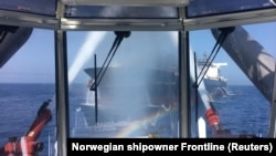 AT SEA -- A photo made available by the Norwegian shipowner Frontline of the crude oil tanker Front Altair during the firefighting of the fire onboard the ship in the Gulf of Oman, June 13, 2019