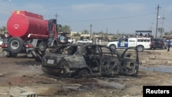 Pamje pas një sulmi të mëparshëm me makinë-bombë në Irak