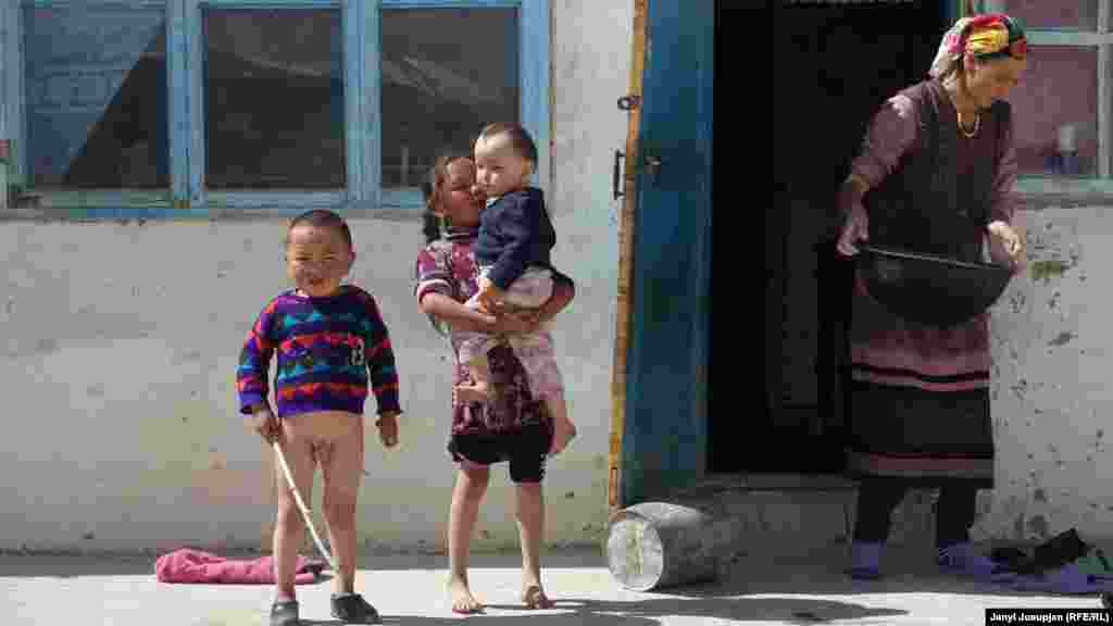 A family in front of their house. The village is 80 percent Kyrgyz and 20 percent Pamiri.