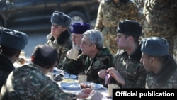 Armenia - President Serzh Sarkisian shares a meal with soldiers on frontline duty in Tavush province, 31Dec2013.