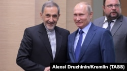 Ali Akbar Velayati (left), a senior adviser to Iran's supreme leader, meets Russia's President Vladimir Putin in Moscow on July 12.