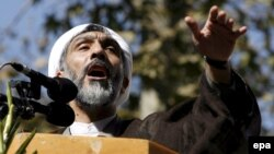 Then-Interior Minister Mostafa Purmohammadi speaks during a state-organized, anti-U.S. demonstration in Tehran in 2007.