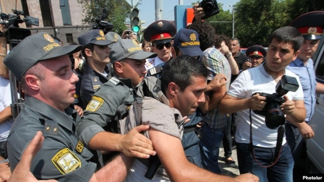 Armenia - Police detain a youth activist protesting against bus fare hikes in Yerevan, 23Jul2013.