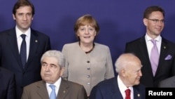 """European Union leaders pose for a """"family portrait"""" ahead of the two-day summit in Brussels."""