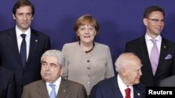 "European Union leaders pose for a ""family portrait"" ahead of the two-day summit in Brussels."