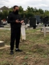Serbia – Refugee from Iran at the separate part of the Orthodox cemetery near the 'Sid station' refugee center (near the Serbia-Croatia border), where refugees and migrants from the Middle East who died trying to cross into Western countries, are buried.