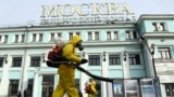 Servicemen of Russia's Emergency Situations Ministry wearing protective gear disinfect Moscow's Belorussky railway station on October 20 amid the ongoing COVID-19 pandemic.