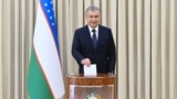 Uzbek President Shavkat Mirziyoev casts his vote in the presidential election on October 24.