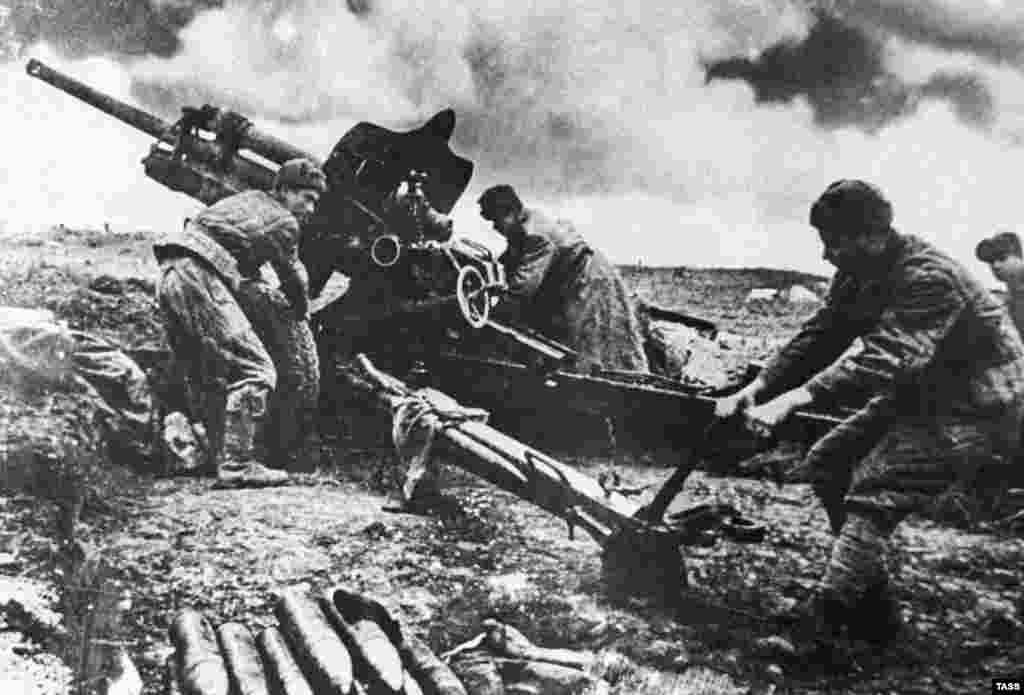 Soviet Union -- Soviet artillerymen shoot at Germans during a battle for Kerch, 1944