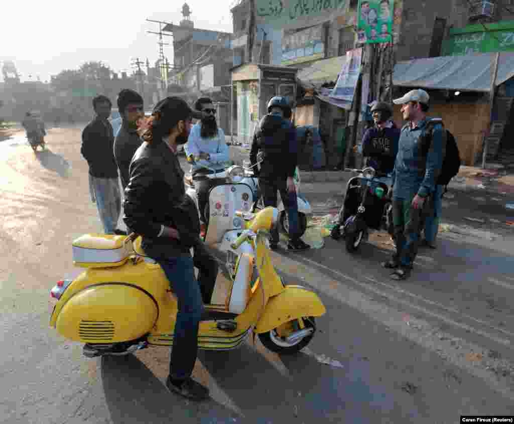 Members of a Vespa riders' club gather at sunrise in Lahore. Piaggio's classic Italian two-wheeler was the ultimate status symbol for Pakistani bike aficionados in the 1960s and 70s when  only a handful of people could afford the elegant machines.
