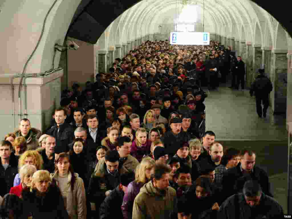 Passengers leave the Park Kultury subway station following the second blast.