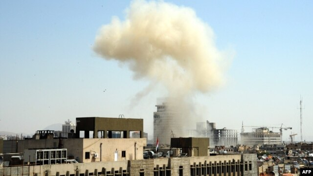 Smoke billows from the site of an apparent blast in the Marjeh district of Damascus on April 30.
