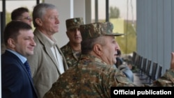 Armenia - CSTO Secretary General Nikolay Bordyuzha (second from left) watches the concluding session of CSTO military exercises at Bagramian shooting range, 3Oct2015.