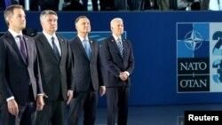 Премьер-министр Бельгии Александр Де Кро, президент Хорватии Зоран Миланович, президент Польши Анджей Дуда и президент США Джо Байден (слева направо) в штаб-квартире НАТО, 14 июня 2021 года.