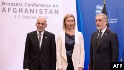 Afghan President Ashraf Ghani (L), EU foreign affairs chief Federica Mogherini (C) and Afghan Chief Executive Abdullah Abdullah arrive for a meeting on Afghanistan at the EU Headquarters in Brussels on October 5.
