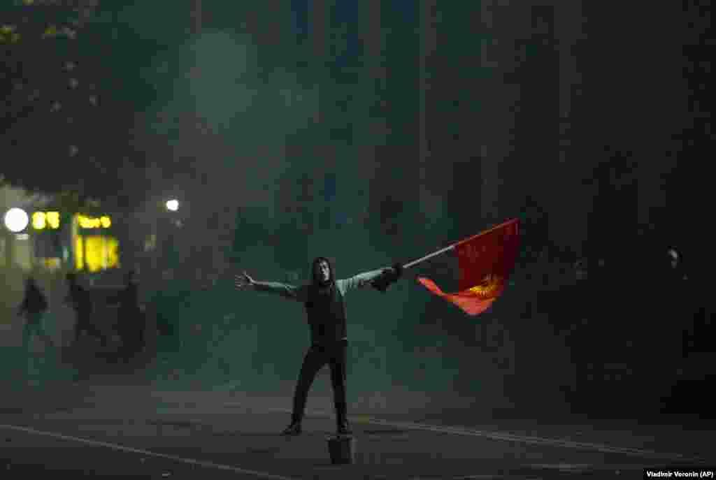 A protester waves a Kyrgyz flag during a rally.