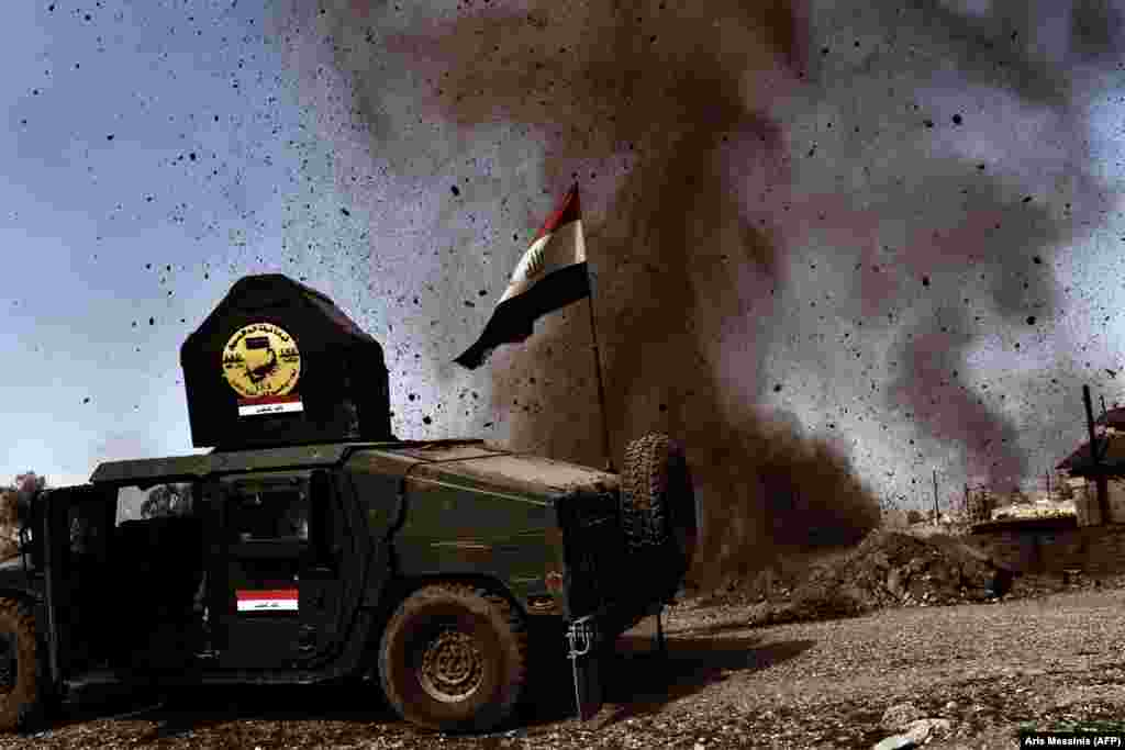 "A mortar thrown by Islamic State militants explodes near an Iraqi Army vehicle on February 25. Mosul is where Islamic State leader Abu Bakr al-Baghdadi made his only public appearance, in July 2014, and proclaimed a ""caliphate,"" which then controlled a third of Iraq."