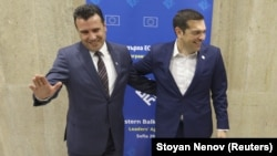Greek Prime Minister Alexis Tsipras (right) meets with Macedonian Prime Minister Zoran Zaev at the EU-Western Balkans summit in Sofia on May 17.