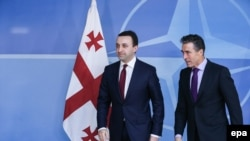 Georgian Prime Minister Irakli Garibashvili (left) with NATO Secretary-General Anders Fogh Rasmussen in Brussels on February 5.