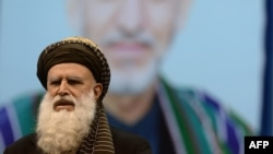 Presidential candidate and former Islamist warlord Abdul Rab Rasul Sayyaf delivers a speech during an election gathering in Kabul, February 6, 2014