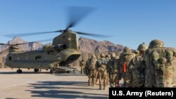 U.S. soldiers load onto a Chinook helicopter to head out on a mission in Afghanistan in January 2019.