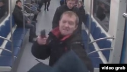 A screen shot from CCTV footage of a bizarre shooting attack that occurred on the Moscow Metro on November 17.