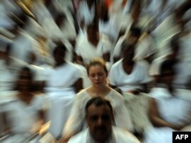 A foreign election observer, together with Sri Lankan citizens, meditate during a special gathering organized in Colombo for a peaceful election.