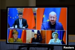 Президент Европейской комиссии Урсула фон дер Ляйен, президент Европейского совета Шарль Мишель, канцлер Германии Ангела Меркель, президент Франции Эммануэль Макрон и президент Китая Си Цзиньпин во время видеоконференции 30 декабря 2020 года.