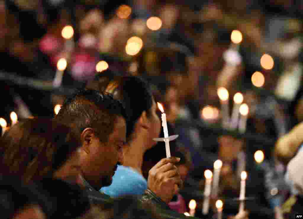 A candlelight vigil for the victims of a mass shooting in San Bernardino, California. A married couple, Syed Rizwan Farook and Tashfeen Malik, attacked a social services center on December 2, 2015, killing 14 people and seriously injuring 22 with automatic rifles, pistols, and pipe bombs. They were killed in a shootout with the police. The couple had sworn allegiance to the Islamic State militant group in social-media posts, officials said.