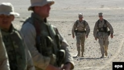 U.S. Defense Secretary James Mattis (second from right) when he was a Marine general, walking with troops in Afghanistan.