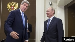U.S. Secretary of State John Kerry (left) and Russian President Vladimir Putin greet each other before the start of nearly four hours of talks in Sochi.