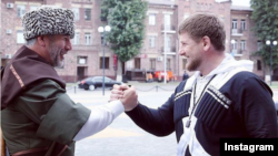 Chechen leader Ramzan Kadyrov (right) and Vakhit Uzmayev, the republic's new presidential and government administration chief and one of Kadyrov's most efficient, ruthless, and feared henchmen.
