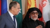 Russian Foreign Minister Sergei Lavrov and Sher Muhammad Stanakzai, head of the Taliban's political office in Qatar during the multilateral peace talks on Afghanistan in Moscow, November 9, 2018